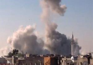 In this image taken from video obtained from the Shaam News Network, smoke rises from buildings from heavy shelling in Homs, Syria, on Dec. 27, 2012.