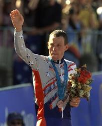 Lance Armstrong waves after receiving the bronze medal in the men's individual time trials at the Summer Olympics in Sydney, 2000.