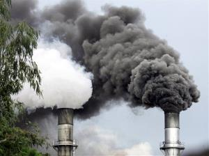 In this May 4, 2008 file photo, huge black smoke is emitted by a sugar mill in Batangas province south of Manila, Philippines.