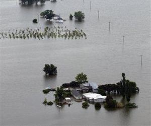In this May 19, 2011 file photo, a row of flooded farm homes are pictured near Yazoo City, Miss.