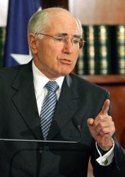 Australian Prime Minister John Howard answers a question at a press conference in Sydney, Australia, in this 2006 file photo.