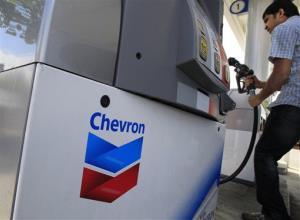 A Chevron customer pumps gas in Mountain View, Calif.