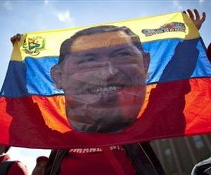 A supporter of Venezuela's President Hugo Chavez holds up a banner bearing the image of the South American leader at a rally in Caracas, Venezuela, Jan. 10, 2013.