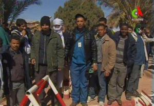 Unidentified rescued hostages pose for the media in Ain Amenas, Algeria, in this image taken from television Friday.