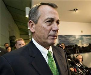 In this Jan. 1, 2013, file photo, Speaker of the House John Boehner, R-Ohio, walks past reporters after a closed-door meeting meeting of House Republicans.