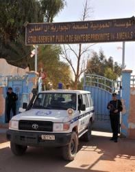Algerian police officers guard the entrance of a hospital located near the gas plant Friday.