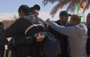 Rescued hostages hug each other on Friday.