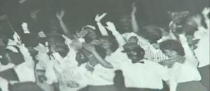 A page from an old Dixie State College yearbook showing students in blackface.
