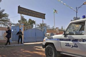 Algerian special police unit officers guard the entrance of an hospital located near the gas plant where hostages have been kidnapped by Islamic militants, in Ain Amenas, Saturday, Jan. 19, 2013.