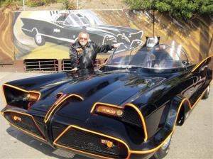 In this October, 2012 photo, famed auto customizer George Barris poses with the original Batmobile in Los Angeles.