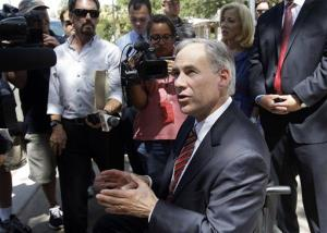 Texas Attorney General Greg Abbott talks with the media as he leaves the Tom Green County Courthouse, July 25, 2011, in San Angelo, Texas.