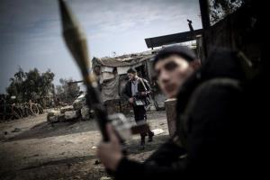 Free Syrian Army fighters hold their weapons during heavy clashes with government forces in Aleppo, Syria, Sunday, Jan. 20, 2013.