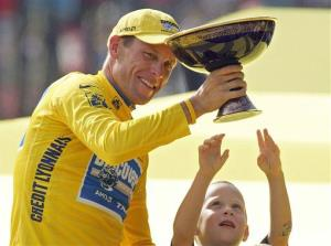 In this July 24, 2005 file photo, Luke Armstrong tries to touch the winner's trophy held by father Lance Armstrong after Armstrong won his seventh straight Tour de France cycling race, in Paris.