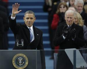 President Barack Obama waves after his speech while Vice President Joe Biden applauds at the US Capitol during the 57th Presidential Inauguration in Washington, Monday, Jan. 21, 2013.