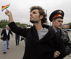 In this 2009 file photo, a gay rights activist is detained by a police officer  in Moscow, Russia.