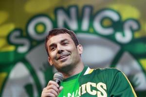 In this June 14, 2012, file photo, investor Chris Hansen smiles as he speaks to supporters of a proposal for a new NBA arena during a rally in Seattle.