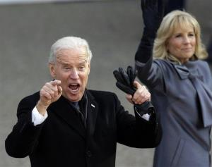 Vice President Joe Biden, with wife Jill, marches down Pennsylvania Avenue en route to the White House during Monday's inauguration.