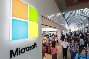 In this Thursday, Aug. 23, 2012, file photo, a new Microsoft Corp. logo, left, is seen on an exterior wall of a new Microsoft store inside the Prudential Center mall, in Boston.