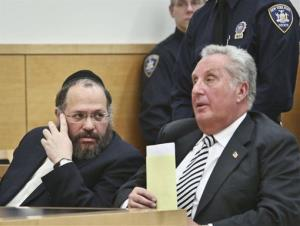 Nechemya Weberman, left, a religious counselor in New York City's ultra-orthodox Jewish community, confers with his lawyer, George Farkas.