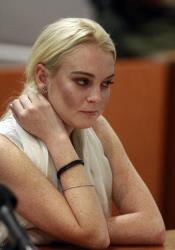 Lindsay Lohan reacts before being taken into custody by Los Angeles Country sheriffs deputies after a judge found her in violation of probation Wednesday, Oct. 19, 2011, in Los Angeles.