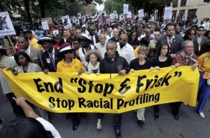 In this Sunday, June 17, 2012 photo, Rev. Al Sharpton, center, walks with thousands along Fifth Avenue, during a silent march to end the stop-and-frisk program in New York.