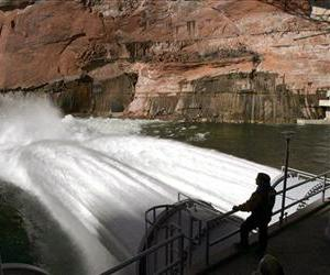 In a Wednesday, March 5, 2008 file photo, water flows from the number one and two jet tubes at the Glen Canyon Dam in Page, Ariz. to mimic natural flooding.