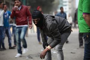 Skirmishes break out between protesters and security forces, unseen, near Tahrir Square, Cairo, Egypt, this morning.
