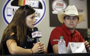 Danica Patrick speaks during a news conference as Ricky Stenhouse Jr., right, looks on, Saturday, May 19, 2012, at Iowa Speedway in Newton, Iowa.