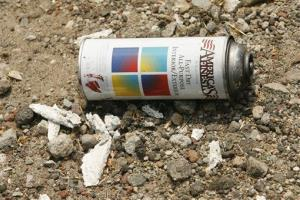 A can of spray paint is left on the ground in an industrial area of the central Los Angeles.
