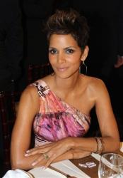 Actress Halle Berry poses at the 70th Annual Golden Globe Awards at the Beverly Hilton Hotel on Sunday Jan. 13, 2013, in Beverly Hills, Calif.