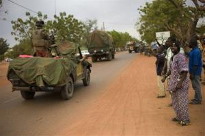 Malian people welcome French soldiers as they arrive in the city of Sevare on Friday.