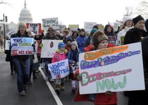 People walk from the U.S. Capitol to the Washington Monument in Washington, Saturday, Jan. 26, 2013, during a march on Washington for gun control.