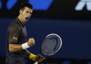 Serbia's Novak Djokovic reacts after winning the second set during the men's final against Britain's Andy Murray at the Australian Open in Melbourne, Australia, Sunday, Jan. 27, 2013.