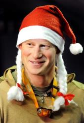 In this Dec. 12, 2012 file photo, Prince Harry wears a Santa hat as he shows media his sleeping area at the VHR (very high readiness) tent, close to the flight-line, at Camp Bastion, Afghanistan.