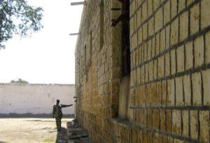 In this 2011 file photo, a prison guard stands near the wall of a prison in Berbera, Somaliland. Britain is asking all citizens to leave the area, citing a specific threat.