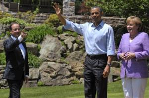 Maybe the gang is getting ready to do some skeet-shooting: Francois Hollande, President Obama, and Angela Merkel at Camp David, Saturday, May 19, 2012.