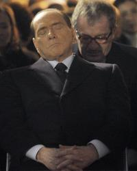Former Italian Premier Silvio Berlusconi, foreground, sits in front of Northern League party's leader Roberto Maroni, in Milan, Italy, Sunday, Jan. 27, 2013.