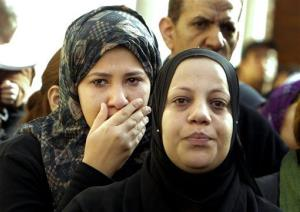 Relatives mourn during the funeral of policemen killed on Saturday in Port Said, in Cairo, Egypt, Sunday, Jan. 27, 2013.