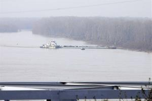 The towboat Nature Way Endeavor banks a barge against the western bank of the Mississippi River, Sunday, Jan. 27, 2013. The river was closed to all traffic eight miles north and south of Vicksburg.