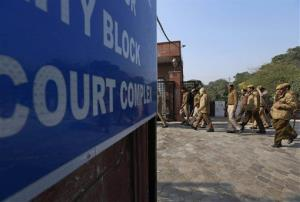 Policemen are deployed in a district court where the accused in a gang rape of a 23-year-old woman are to be tried, in New Delhi, India, Monday, Jan. 21, 2013.