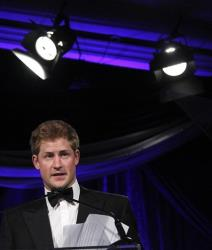 Britain's Prince Harry speaks after receiving the Atlantic Council's 2012 Distinguished Humanitarian Leadership, Monday, May 7, 2012, in Washington.