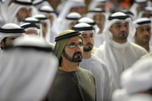 Sheikh Mohammed bin Rashid Al Maktoum, UAE Prime Minister and ruler of Dubai, centre, watches the Dubai Gold Cup race, Saturday, March 31, 2012, in Dubai, United Arab Emirates.