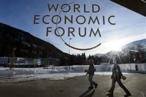 Participants leave the Congress Center the last day of the 43rd Annual Meeting of the World Economic Forum, WEF, in Davos, Switzerland, Saturday, Jan. 26, 2013.