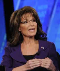 Former Alaska Gov. Sarah Palin talks on Fox News Sunday last year.