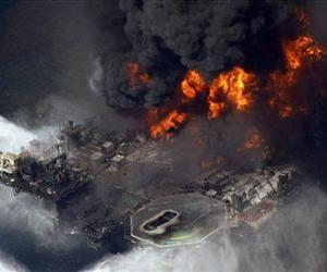 In this April 21, 2010 file aerial photo, the Deepwater Horizon oil rig burns in the Gulf of Mexico.