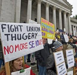 Hundreds of demonstrators stand on the steps of the Washington State Capitol to protest  against unions on Saturday, Feb. 26, 2011 in Olympia, Wash.