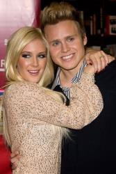 In this Nov. 16, 2009 file photo, Heidi Montag, left, and Spencer Pratt pose at a book signing event for their book How To Be Famous at Borders Books in New York.