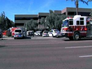 This frame grab provided by abc15.com shows the scene at a Phoenix office complex.