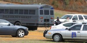 Police SWAT teams and hostage negotiators are gathered at standoff and hostage scene in Dale County near Midland City, Ala. on Wednesday, Jan. 30, 2013.