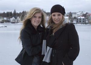 In this Sunday, Dec. 30, 2012 photo, Blaer Bjarkardottir, 15, left, and her mother, Bjork Eidsdottir, are photographed in front of a pond in Reykjavik.